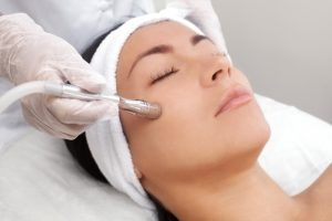 a patient getting a microdermabrasion treatment
